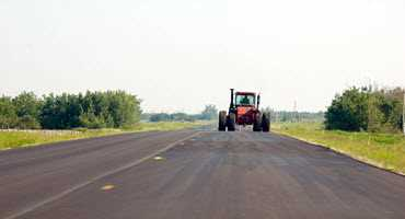 Answering questions about Manitoba's road rules for farm equipment