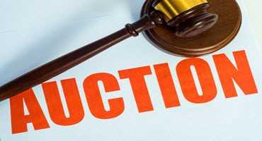 John Deere windrower featured in BigIron auction