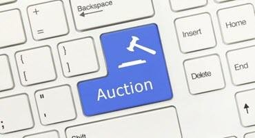 New Holland tractor tops BigIron auction