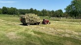 Making small square bales of hay & g...