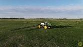 John Deere R4045 Spraying Wheat